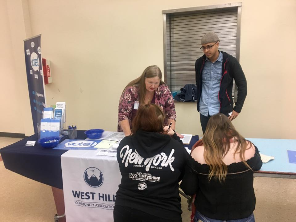 WHCA Board President Jeremy Williams and Secretary Margie Lindberg assist Renton High School students with voter registration, October 2019