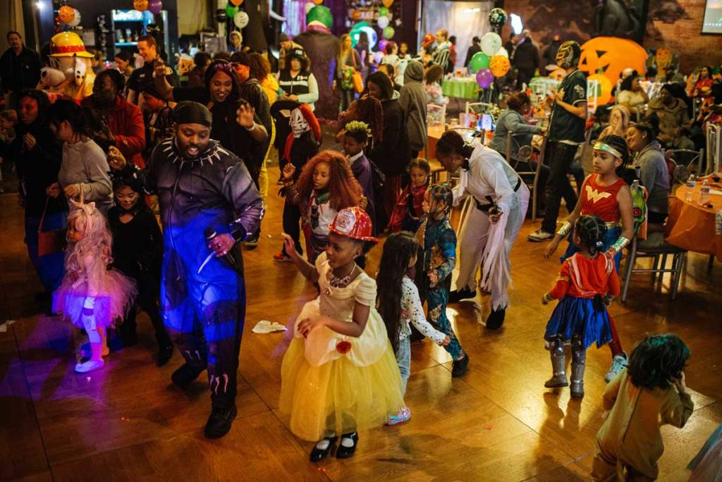 Crowd dancing from above at West Hill Community Association WHCA Halloween Takeover at Skyway Park Bowl's Lucky Dragonz event space, October 28, 2019 - Caroline Walker Evans Photography