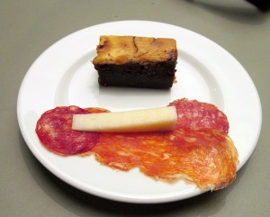 Enjoying salamis cheese and a brownie