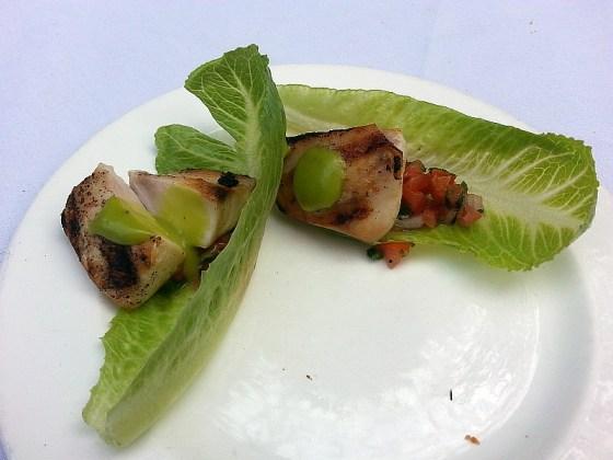 Grilled mahi mahi with salsa on romaine lettuce leaf