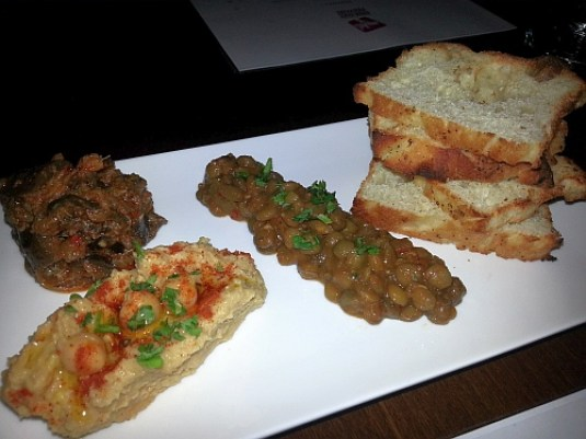 Morocco West Trio: Hummus, zaalouk, and lentil salad with house-made bread