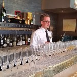 Joshua Carlson ready to offer a glass of Champagne at TWB The Wine Bar