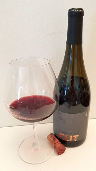 Winemaker's CUT Syrah 2016 with wine in glass