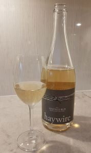 Haywire Vintage Bub 2013 with wine in glass