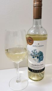 Santa Carolina Sauvignon Blanc Reserva 2017 with wine in glass