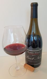 Black Hills Estate Winery Pinot Noir 2017 with wine in glass