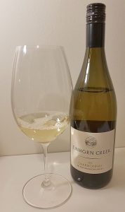 Tinhorn Creek Vineyards Chardonnay 2017 with wine in glass