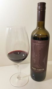 Tinhorn Creek Vineyards The Creek 2015 with wine in glass