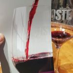 Taste WA booklet and glass of wine