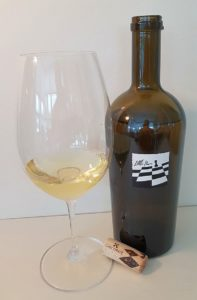 CheckMate Artisinal Winery Little Pawn Chardonnay 2014 with wine in glass