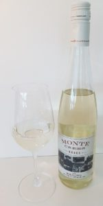 Monte Creek Ranch Riesling Reserve 2018 with wine in glass