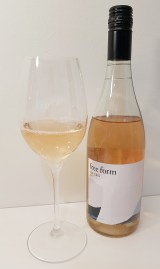 Okanagan Crush Pad free form Vin Gris 2017 with wine in a glass
