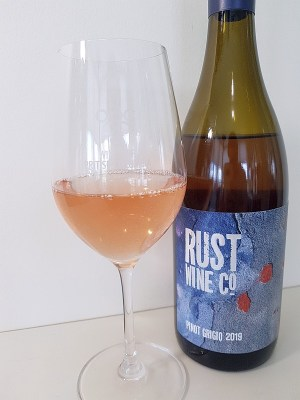 Rust Wine Co Pinot Grigio 2019 with wine in glass