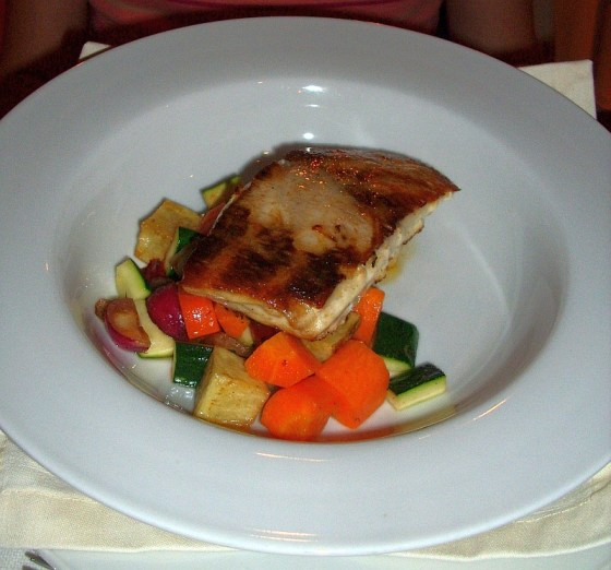 Grilled Chilean sea bass over vegetables