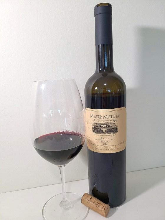 Casale del Giglio Mater Matuta Rosso IGT 2016 with wine in glass