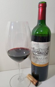 Château de Marsan, Cotes de Bordeaux 2010 with wine in glass