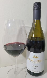 Gold Hill Syrah 2016 with wine in glass