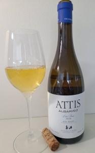 Attis Albariño Lias Finas 2018 with wine in glass