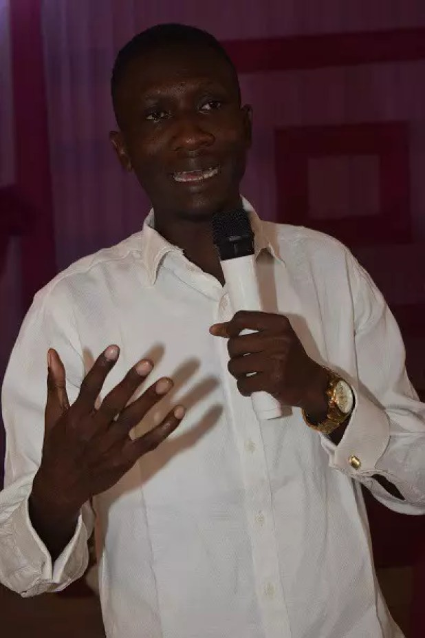 Johnson Okunade speaking as an invited guest speaker at summer teen camp, Ijegun Lagos