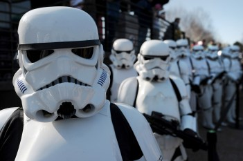Star Wars Stormtroopers pose for photographers in a queue at Legoland in Windsor west of London on March 24, 2012, to mark the launch of the new Star Wars Miniland Experience. AFP PHOTO/CARL COURT (Photo credit should read CARL COURT/AFP/Getty Images)