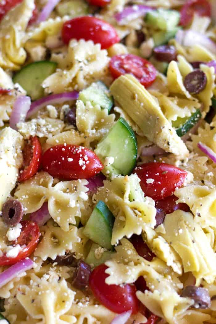 This delicious and Easy Greek Pasta Salad is the perfect addition to your next summer BBQ!