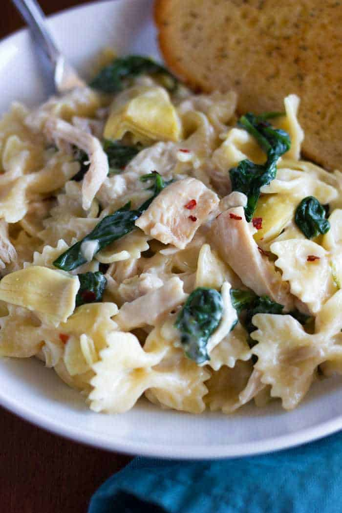 Serve this Spinach Artichoke Chicken Pasta with some garlic toast and a side salad for a simple and yummy weeknight dinner!