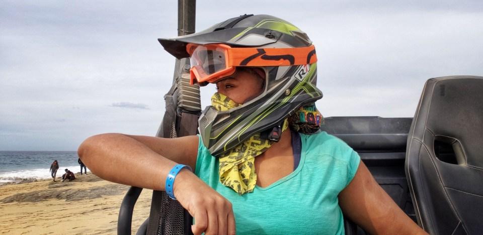 Black woman in off roading gear on beach