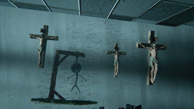 Foto zeigt drei Jesuskreuze und einen gemalten Hangman sowie Handgeschriebenes an einer Wand.