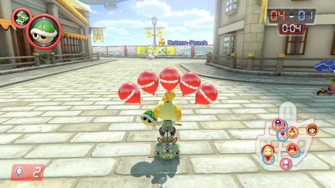 """Das Bild zeigt einen Spielausschnitt aus dem Modus """"Ballonschlacht"""". Melinda hält einen grünen Panzer und verfügt noch über alle fünf Luftballons."""