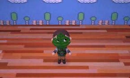 Das Bild zeigt einen Charakter aus Animal Crossing: New Leaf. Er trägt ein Blatt vor dem Gesicht, bekannt auch als Makar`s Mask.