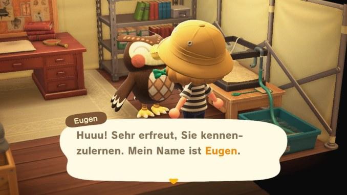 Das Bild zeigt einen wichtigen Teil von Animal Crossing: New Horizons. Unser Avatar unterhält sich gerade mit Eugen. Es handelt sich bei ihm um eine Eule. Man erkennt ein Regal, einen Schreibtisch und einem Aquarium im Hintergrund.