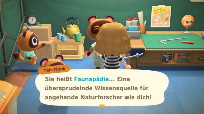 Das Bild zeigt einen wichtigen Teil von Animal Crossing: New Horizons. Unser Avatar unterhält sich gerade mit Tom Nook, welcher uns die App Faunapädie erklärt.
