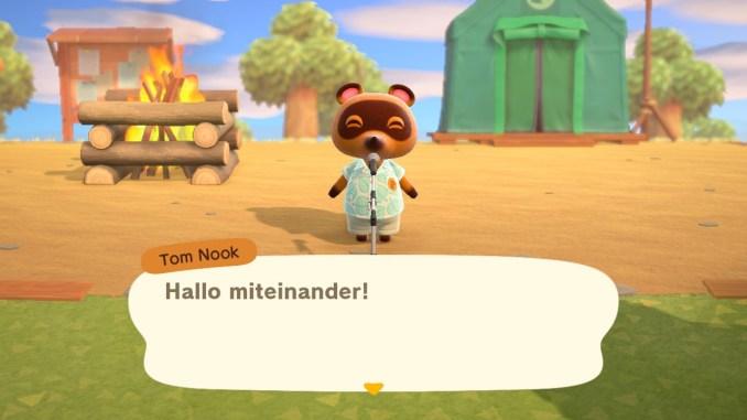 Das Bild zeigt einen wichtigen Teil von Animal Crossing: New Horizons. Man erkennt Tom Nook, welcher uns jeden Morgen auf der Insel begrüßt. Im Hintergrund erkennt man das schwarze Brett, das Service-Zelt und ein Lagerfreuer.