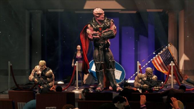 Das Bild zeigt den Alien-Anführer Zinyak, wie er in die Pressekonferenz des Präsidenten platzt.