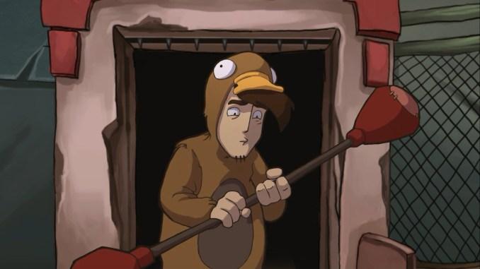 Das Bild zeigt Rufus in einem Ganzkörper-Schnabeltieranzug mit einer Bataka in den Händen.