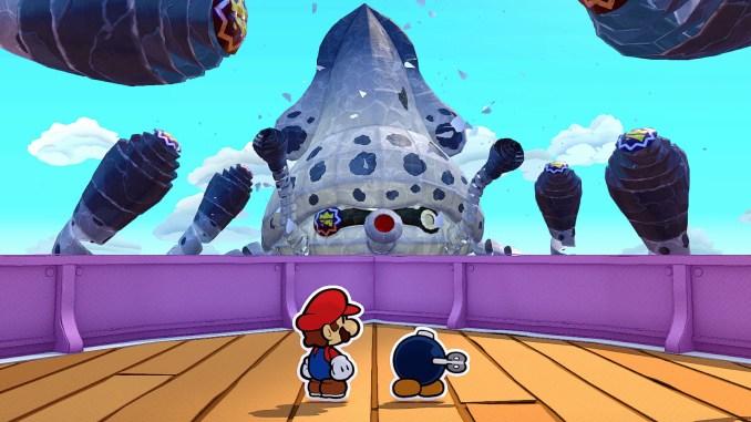 """Das Bild zeigt Mario mit einem Bob-Omb aus dem Spiel """"Paper Mario: The Origami King""""."""