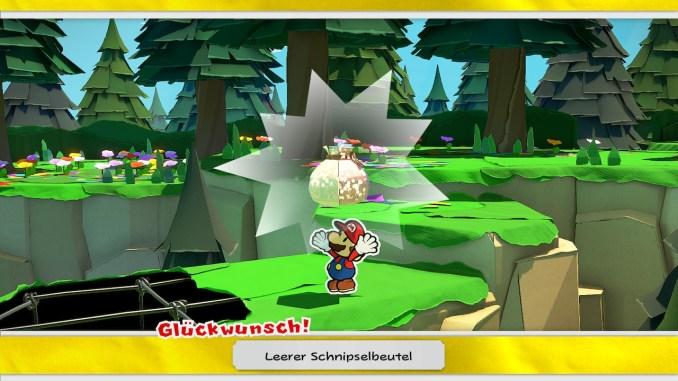 Das Bild zeigt Gameplay zum Flüsterforst. Mario erhält den leeren Schnipselbeutel.