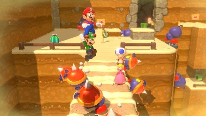 """Das Bild zeigt eine chaotische Szene zu viert in """"Super Mario 3D World."""""""