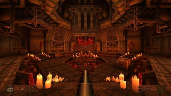 """Auf diesem Screenshot des Spiels """"Quake"""" ist ein roter Raum mit vielen Kerzen zu sehen."""