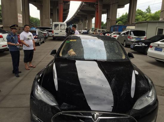 特斯拉專車被抓 罰款一萬車輛被扣(圖)