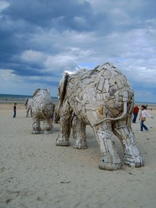Wooden elephant sculpture on the beach