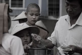 Young Buddhist Nuns Collecting Alms
