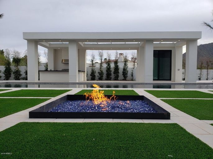 Fire pit and grassy grounds