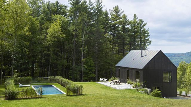 The home overlooks a wooded area.