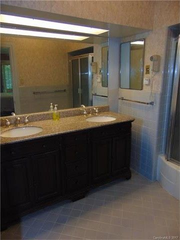 The bathroom was previously drab and dated.