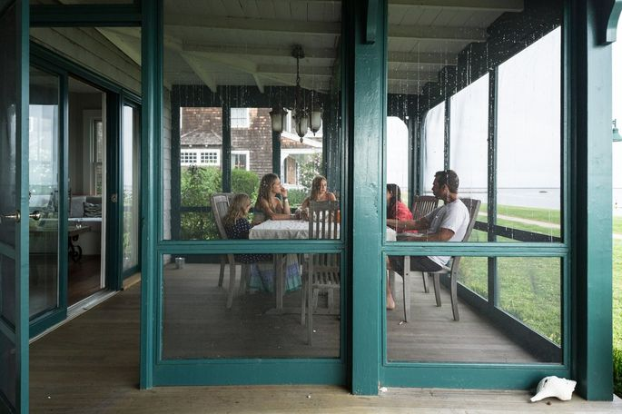 Ms. Grant with her husband, Jeff Krasno, and three daughters on the porch of the Fenwick cottage, which is listed for sale for $3.375 million.