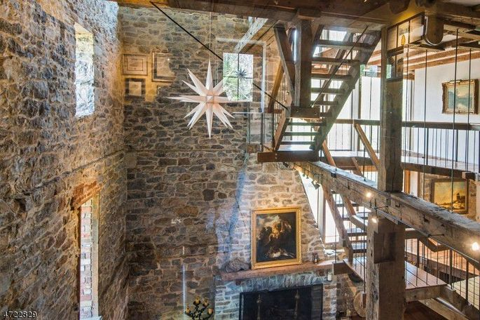 Open staircase in four-story converted mill