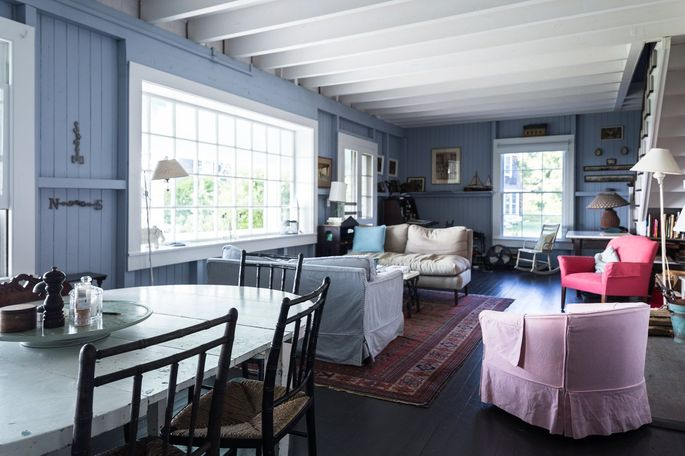 The living room of the cottage is lined with pictures, family mementos and books.