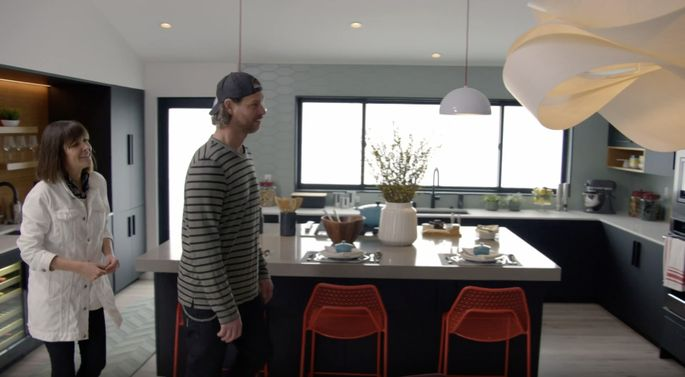 Leanne and Steve Ford wander around Jonathan's renovated kitchen.