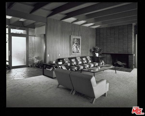 The classic Mid-Century Modern Asher House living room closer to the time it was originally constructed
